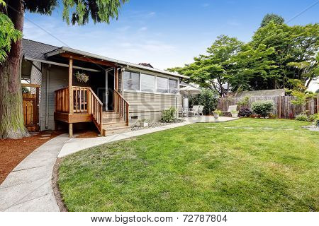 House With Small Walkout Deck To Backyrd Area