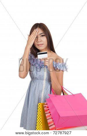 Exhausted Asian Woman Fed Up Hold Shopping Bags And Credit Card