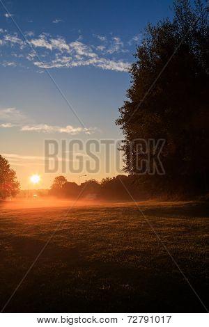Sunrise over urban park