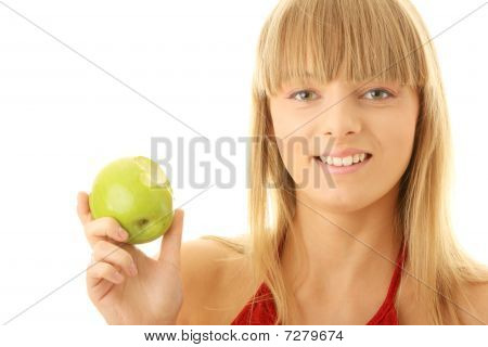 Young Blond Woman With Green Apple