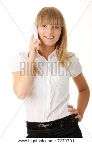 Portrait Of Happy Smiling Businesswoman On Phone At Office