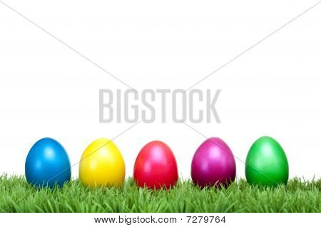 Several Colorful Easter Eggs On A Green Meadow