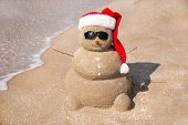 stock photo of snowman  - Snowman made out of sand - JPG
