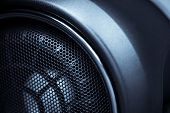 picture of membrane  - Close up shot of a round speaker in a car - JPG