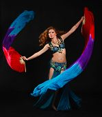 pic of belly-dance  - woman in carnival costume with a fan on black - JPG