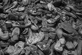 foto of loafers  - A pile of very old shoes in black and white