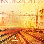 stock photo of high-speed train  - Departure of high speed train at sunset - JPG