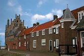 stock photo of veer  - historic buildings along cobbled street in Veere - JPG