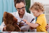 stock photo of auscultation  - Child auscultating teddy bear at pediatrician - JPG
