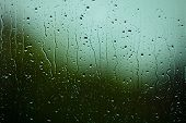 picture of raindrops  - Closeup of water drops droplets raindrops on glass window as background texture - JPG