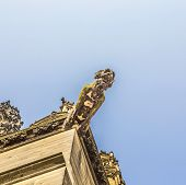 picture of gargoyles  - ugly gargoyle sculpture at the dome in cologne - JPG
