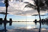 image of infinity pool  - blue sky reflected into an infinity pool - JPG