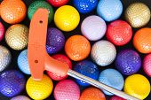pic of miniature golf  - Assorted Mini Golf balls with an orange club - JPG
