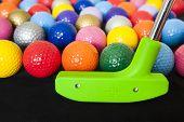 pic of miniature golf  - Colorful mini golf balls with a green club - JPG
