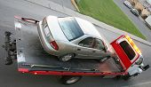 foto of towing  - Car being towed on a flatbed truck - JPG