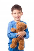 picture of pajamas  - Cute boy in pajamas hugging a teddy bear - JPG