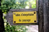 picture of interpreter  - arrow indicating the direction to go to the guidance or interpretation of the landscape in the mountains of the Cevennes table - JPG