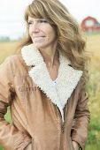 stock photo of 55-60 years old  - A Woman on wheat have good time - JPG
