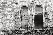 stock photo of niche  - abstract fragment of monochrome tone of an old brick wall with window niches - JPG
