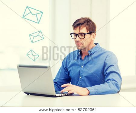 technology, business and communication concept - man in eyeglasses working with laptop at home