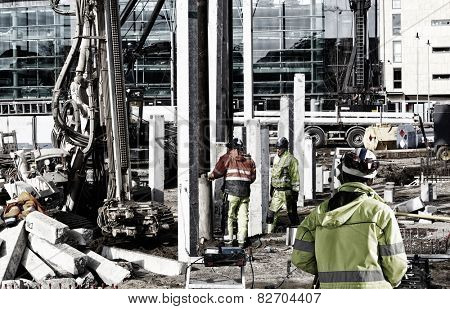 surveyors and workers inside construction plant