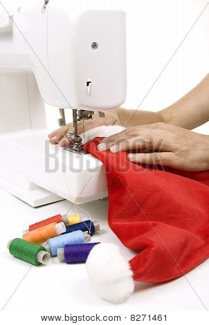 Woman Sewing A Hat For Santa Claus
