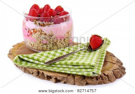 Healthy breakfast - yogurt with  strawberries and muesli served in glass jar, on wooden board, isolated on white