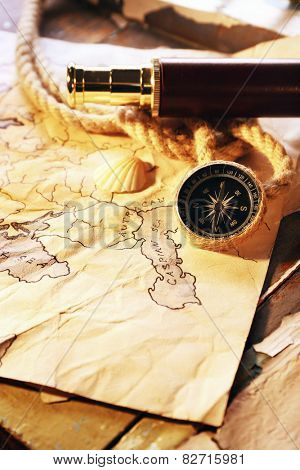 Marine still life spyglass and world map on old wooden background