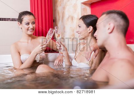 Young People Relaxing In The Hot Tub