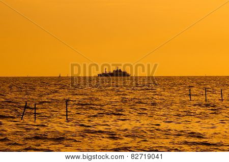 Silhouette of an ocean liner at sunset