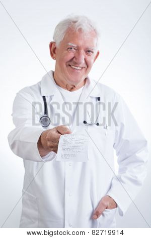 Senior Doctor Giving Prescription