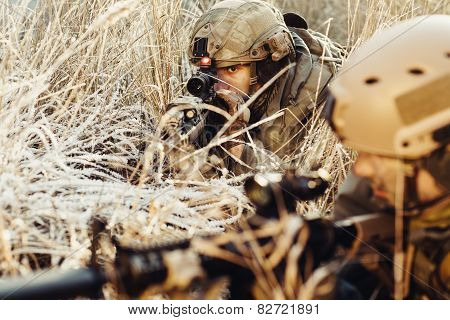 Two Soldiers In An Ambush Aim At The Enemy