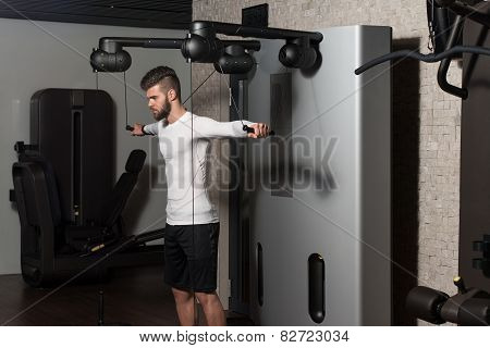 Healthy Young Man Doing Exercise For Shoulders