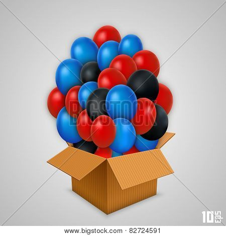 Open paper box with balloons