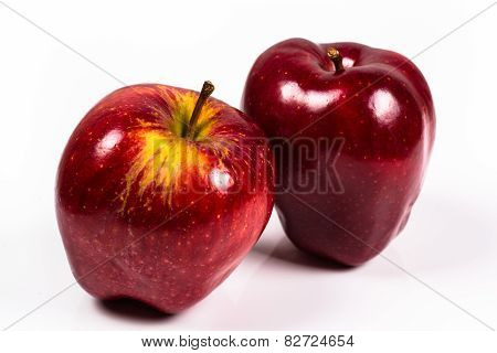 Two Red Delicious Apple On A White Background