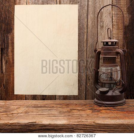 lamp oil lantern paper blank old wooden background