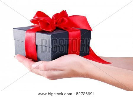 Woman's hands holding gift box isolated on white