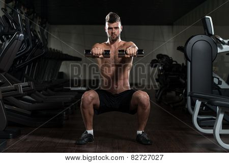 Young Man Doing Exercise Dumbbell Squat