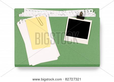 Office Folder With Untidy Note Paper And Blank Photo