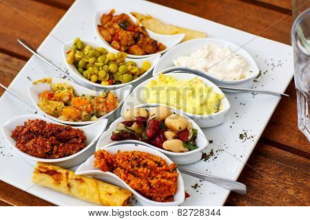 Differen Appetizer And Anti Pasti On White Plate In Cafe Or Restaurant.