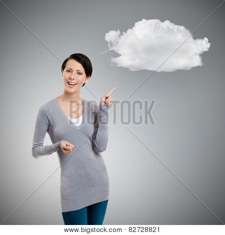 Gesturing forefinger to cloud, grey background