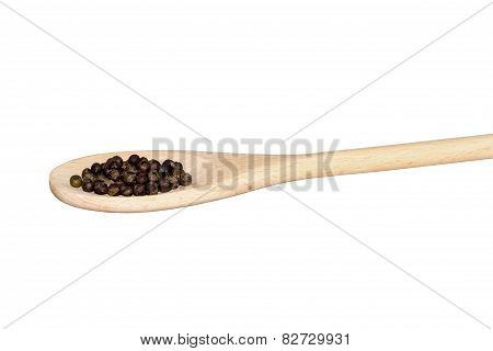 Black Pepper On A Light Wooden Spoon