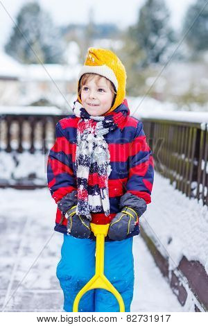 Funny Little Boy In Colorful Clothes Happy About Snow, Outdoors