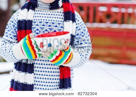 Hands Of Little Child Holding Big Cup With Snowflakes And Hot Chocolate Drink
