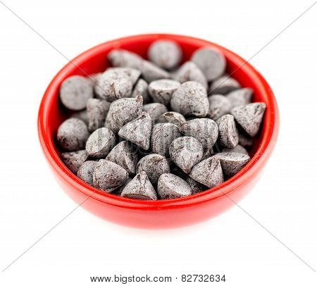 Bowl Filled With Chocolate Chips Isolated On White