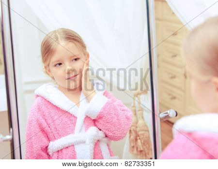 Cute little girl in the bathroom