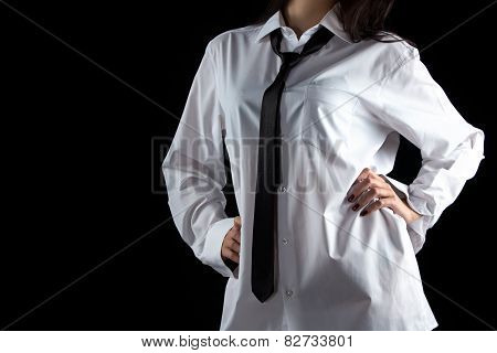 Woman with hands on hips in men's shirt