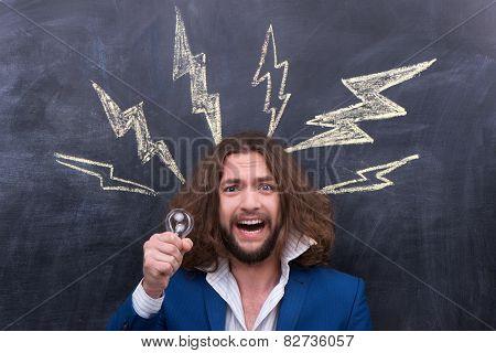 Male holding bulb, idea bulb concept