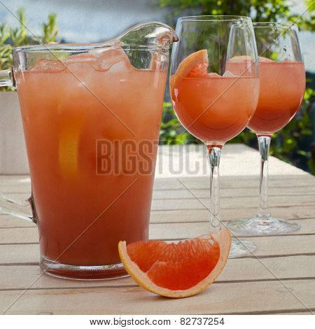 Grapefruit Lemonade Pitcher With Two Glasses, Sliced Grapefruit On The Wooden Table.  Vintage Paper