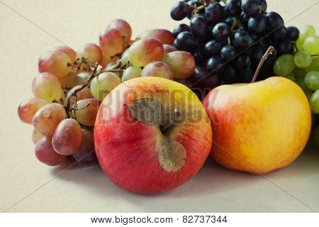 Apples, Red, Green And Purple (violet) Grapes On A Vintage Paper Background. Thanksgiving Day. Harve
